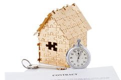 Home of gold color puzzles with a stopwatch Royalty Free Stock Image