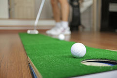 Home Golf Putt Practicing Stock Images