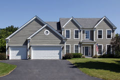 Home with gray siding and covered entry royalty free stock photos