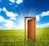 Home and green. Home door open in a green clean field Royalty Free Stock Photography