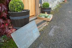 Home grown vegetables for sale on a doorstep Stock Image