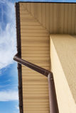 Home Guttering, Gutters, Plastic Guttering System, Guttering & Drainage Pipe Exterior against blue sky. Home Guttering, Gutters, Plastic Guttering System Royalty Free Stock Image