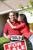 Home: Guy Excited for New Home. Extensive series of a Caucasian Real Estate Agent and African-American Couple in front of a home Stock Photos