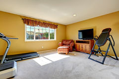 Home gym room with exercise equipments Royalty Free Stock Images