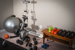 Home Gym Workout Area. Weights, Ball Rack and Barbell Royalty Free Stock Image