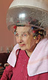 Home hairdressing for the elderly Stock Photos