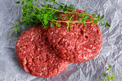 Home HandMade Raw Minced Beef steak burgers on scrumbled paper Stock Photos