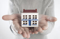 Home in hands royalty free stock image