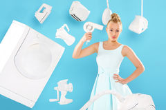 Home on the head - mother, wife , housewife - work at home. Young housewife overwhelmed by tasks associated with running a home. Joyful woman does housework Royalty Free Stock Photo