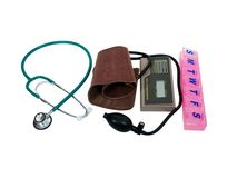 Home health care. Blood pressure cuff, stethoscope and daily pill box for home monitoring for health maintenance-Path included Royalty Free Stock Photos