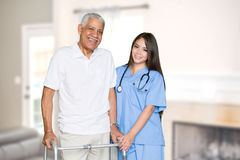 Home Health Care. Nurse giving care to an elderly patient at home Royalty Free Stock Images