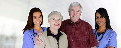 Home Health Care. Worker and an elderly couple Stock Photos