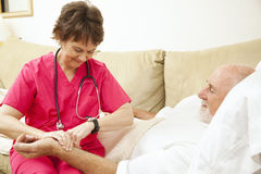 Home Health Nurse Takes Pulse Stock Photo