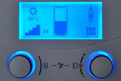 Home heating automation control unit with blue display. Showing working hot water solar system royalty free stock photography