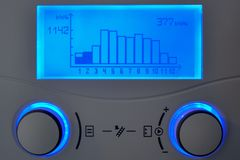 Home heating automation control unit with blue display. Showing solar energy annual yield stock images