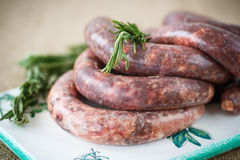 Home hepatic raw sausage with rosemary Royalty Free Stock Photography