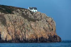 Home on high cliff Stock Photography