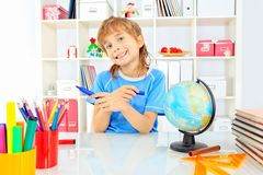 Home hobby. A boy doing his lessons at home stock photos
