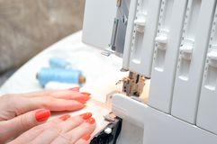 Home hobby. manufacture of textiles at home. Sewing process stock photography