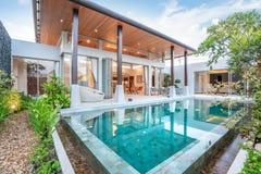 Home or house building Exterior and interior design showing tropical pool villa with green garden stock photos