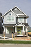 Home House Exterior Construction Siding. Exterior view of a new tiny affordable home with gray siding royalty free stock photography