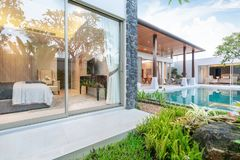 Home or house Exterior design showing tropical pool villa with greenery garden and bedroom stock photography