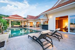 Home or house Exterior design showing tropical pool villa with sun bed stock photos