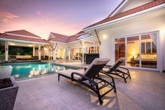 Home or house Exterior design showing tropical pool villa with sun bed stock photo