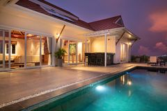 Home or house Exterior design showing tropical pool villa with sun bed stock photography
