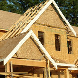 Home House Exterior Framing. New house under construction in British Columbia stock photography