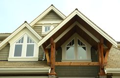 Home House Exterior Windows. Front entrance details of a custom built westcoast home royalty free stock image