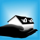 Home house in hand on blue background Royalty Free Stock Photos