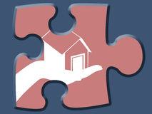 Home house in hand on a jigsaw puzzle piece Royalty Free Stock Photo