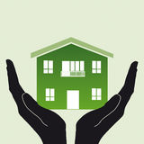 Home house in hands Stock Image