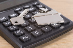 Home, house key and calculator keyboard Stock Images