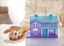 home and house key on a female hand Royalty Free Stock Photo