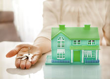 home and house key on a female hand Royalty Free Stock Photos