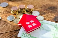 Free Home House On The Staked Coins Background Euro Pile Pack Real Estate Concept Expenses Property Buying Mockup Copy Space Close Up Stock Photo - 168397950