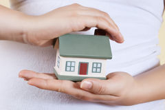 Home in human hands Royalty Free Stock Photography