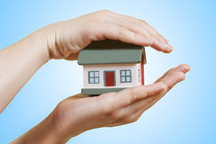 Home in human hands Stock Image
