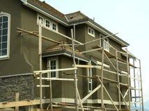 home hus för konstruktion under Arkivfoto