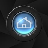 Home icon. Blue home icon with metal border over black background stock illustration