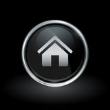 Home icon inside round silver and black emblem Royalty Free Stock Photo