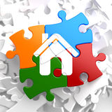 Home Icon on Multicolor Puzzle. Royalty Free Stock Photography