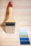 Home improvement. Painting brush and  gamut prints (created and made by me) selective focus Stock Image