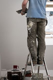 Home improvement. Spackling the wall stock photography