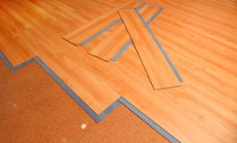 Home improvement. Project of laying new vinyl flooring Royalty Free Stock Images