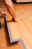 Home improvement. Project of laying new vinyl flooring Royalty Free Stock Photography