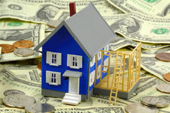 Home Improvement 2. Minaiture House on Money. Part od Home Improvement Series - See Portfolio For Similar Concepts