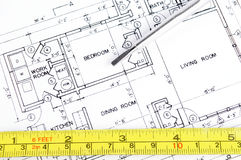Home Improvement. House blueprint with a measuring tape and a screwdriver on top of it Royalty Free Stock Photos